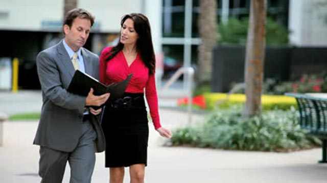 stock-footage-businessman-and-assistant-working-and-walking-outdoors